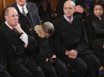 One would think Kennedy would give Justice Ginsberg a gentle nudge so she doesn't fall out of her chair during the State of the Union.